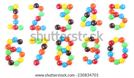 Numbers made of chocolate candies isolated on white - stock photo