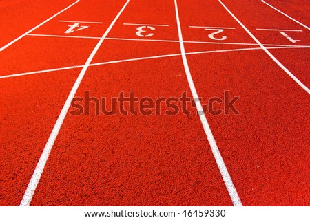 Numbers of a racetrack, on red tarmac, for runners - stock photo