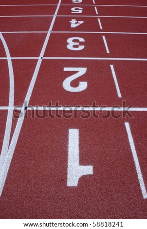 Numbers of a racetrack on red tarmac for runners abstract arena athlete - stock photo