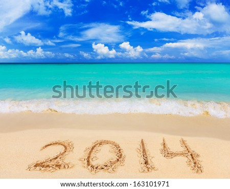 Numbers 2014 on beach - concept holiday background