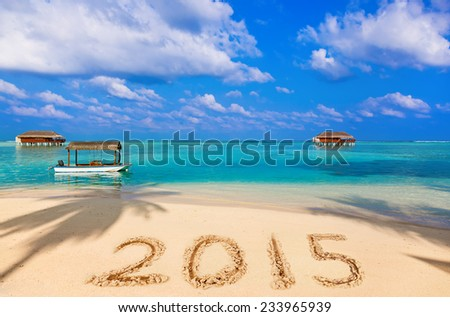 Numbers 2015 on beach - concept holiday background - stock photo