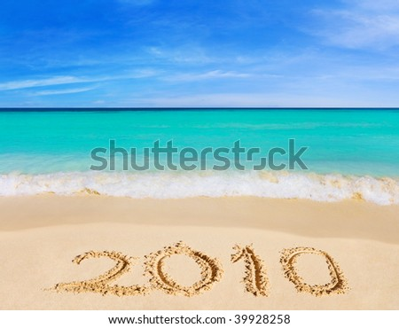 Numbers 2010 on beach - concept holiday background - stock photo
