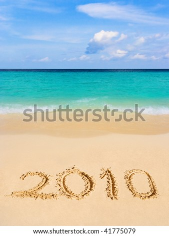 Numbers 2010 on beach - concept holiday background