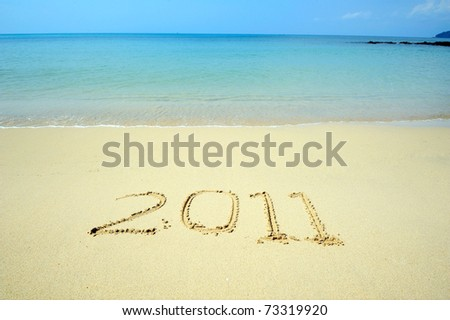 Numbers 2011 on beach - concept holiday background - stock photo