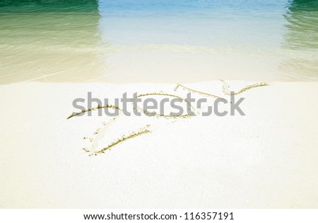 Numbers 2012 on beach sand - stock photo
