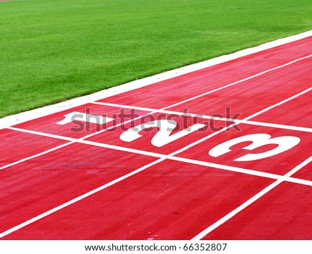 Numbers on running track - added vignette lets you focus on the numbers - stock photo