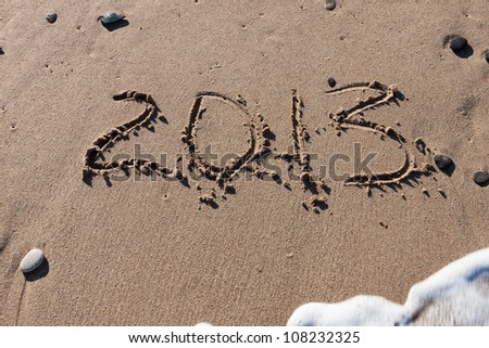Numbers 2013 on the beach sand - stock photo