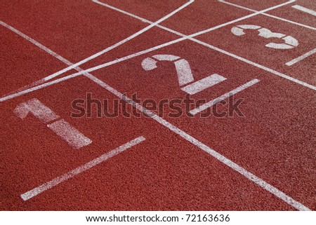Numbers on the start of a running track - stock photo