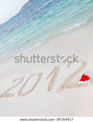 Numbers 2012 on tropical beach sand - stock photo