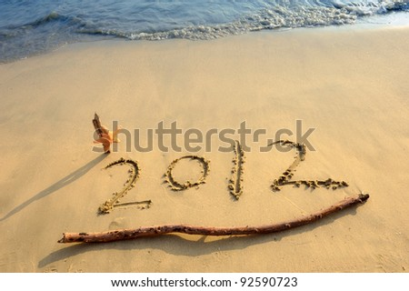 Numbers 2012 on tropical beach sand with starfish - stock photo