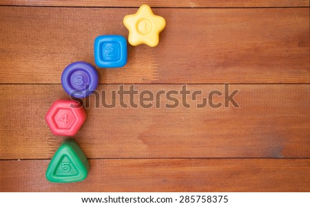 Numbers on wooden background - stock photo