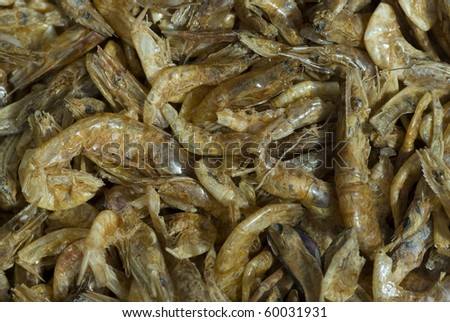 Numeral dried shelled shrimps background - stock photo
