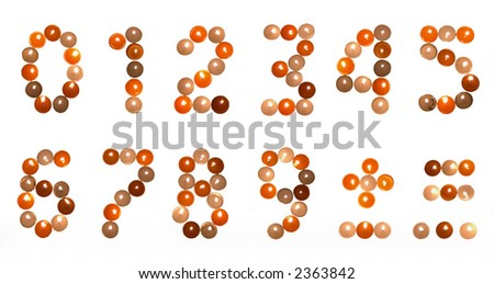 numeral font formed of multicolored tea candles (isolated on white)