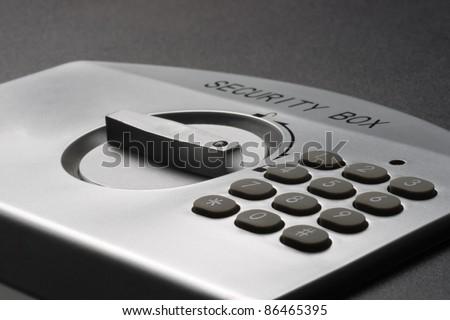 numeric keypad of a laptop safe - stock photo