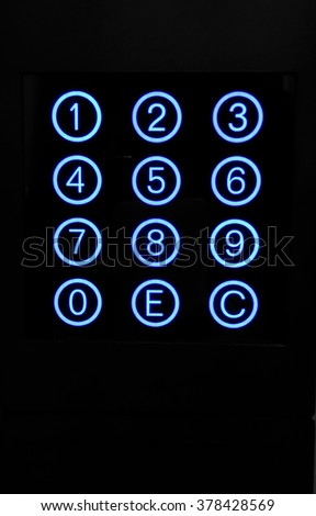 Numeric keypad with blue circular buttons - stock photo