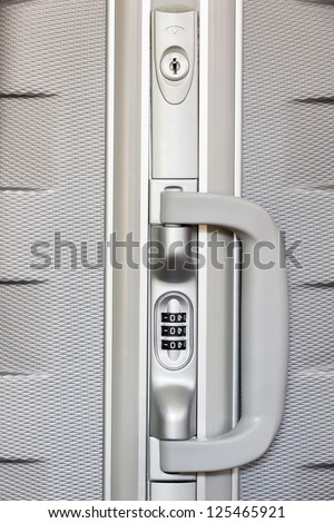 Numeric lock on travel bag - stock photo