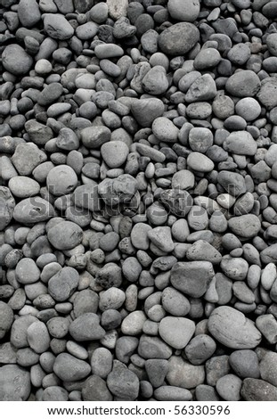 Numerous gray round pebble stones texture background - stock photo