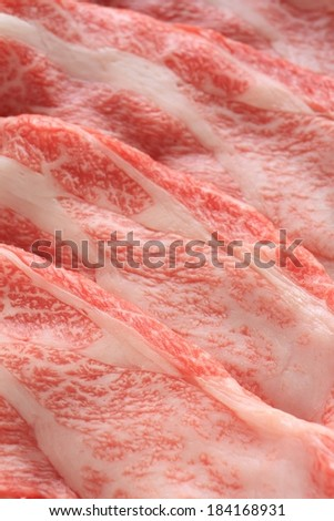 Numerous pieces of raw meat threaded with fat. - stock photo