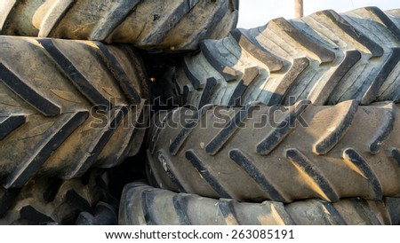 Numerous tires stacked on top of each other - stock photo