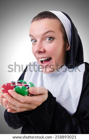 Nun in the gambling concept - stock photo