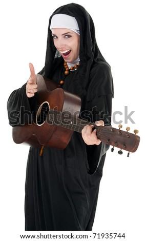 Nun pretending to shoot through her index finger - stock photo