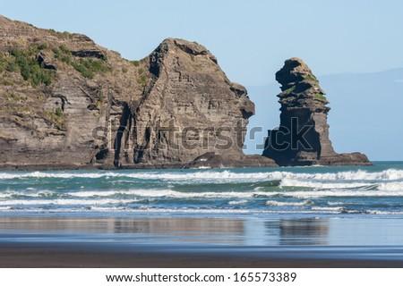 Nun Rock at Piha beach, New Zealand - stock photo