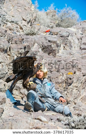NURA, KAZAKHSTAN - FEBRUARY 12: Eagle on man's hand in Nura near Almaty on February 12, 2016 in Nura, Kazakhstan. The traditional event happens yearly and the place becomes as a medieval times city.