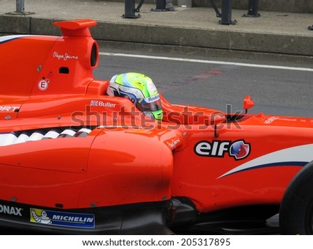 NURBURG, GERMANY - JULY 12, 2014:  British racing driver William Buller (Arden Motorsport) driving through the pitlane during the World Series by Renault event on July 12, 2014 at Nurburg, Germany. - stock photo
