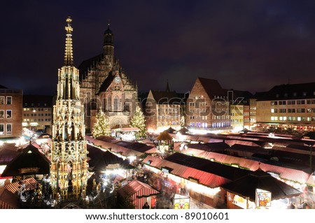NUREMBERG, GERMANY - DEC 12: Christkindlesmarkt at dusk  on 12. December. 2010 in Nuremberg, Bavaria, Germany. It is one of the large christmas markets in Germany. - stock photo