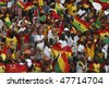 NUREMBERG, GERMANY - JUNE 22:  Ghanaian supporters cheer during a 2006 FIFA World Cup soccer match against the United States June 22, 2006 in Nuremberg, Germany. - stock photo