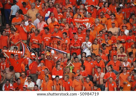 NUREMBERG, GERMANY - JUNE 25:  Holland supporters in the stands during a round 16  World Cup soccer match between Portugal and the Netherlands June 25, 2006 in Nuremberg, Germany. - stock photo