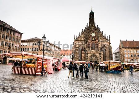 NUREMBERG, GERMANY - 5 MARCH 2016:View on tourists walking in the sidewalk in Hauptmarkt in Nuremberg - stock photo