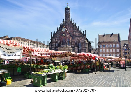 NURNBERG, GERMANY - JULY 02, 2015: Nuremberg Cathedral, Frauenkirche at Main Market Square. Gothic church was built in the grand market between 1352 and 1362, the architect Peter Parler.  - stock photo