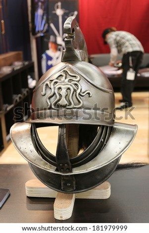 NURNBERG, GERMANY - MARCH 9: Ancient helmet replica from Supreme Replicas on display at IWA 2014 & Outdoor Classics exhibition on March 9, 2014 in Nurnberg, Germany - stock photo