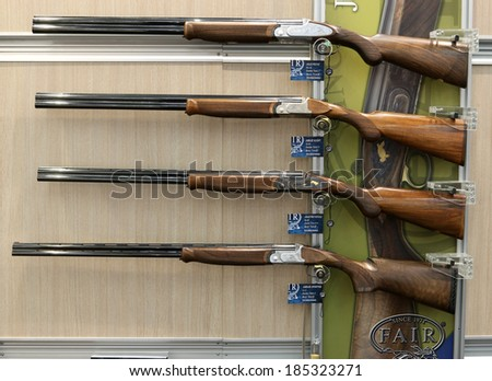 NURNBERG, GERMANY - MARCH 9: Fine shotguns family on display at IWA 2014 & Outdoor Classics exhibition on March 9, 2014 in Nurnberg, Germany - stock photo
