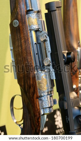 NURNBERG, GERMANY - MARCH 9: Fuchs hunting shotguns and rigles on display at IWA 2014 & Outdoor Classics exhibition on March 9, 2014 in Nurnberg, Germany - stock photo