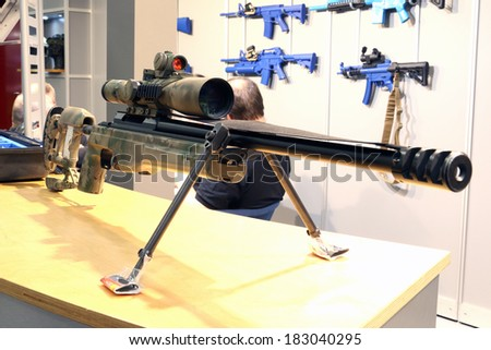 NURNBERG, GERMANY - MARCH 9: Spuhr scope mounting systems on display at IWA 2014 & Outdoor Classics exhibition on March 9, 2014 in Nurnberg, Germany - stock photo