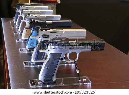 NURNBERG, GERMANY - MARCH 9: Tanfoglio handguns on display at IWA 2014 & Outdoor Classics exhibition on March 9, 2014 in Nurnberg, Germany - stock photo