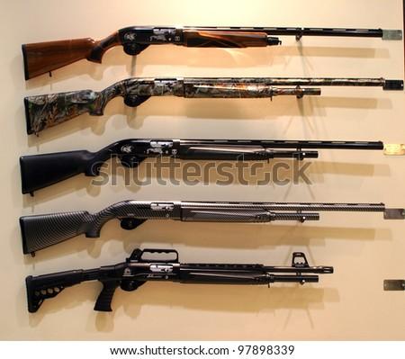 NURNBERG, GERMANY - MARCH 11: Torunarms tactical shotguns on display at IWA 2012 & OutdoorClassics exhibition on March 11, 2012 in Nurnberg, Germany - stock photo