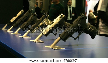 NURNBERG, GERMANY - MARCH 11: Walther P22 pistols on display at IWA 2012 & Outdoor Classics exhibition on March 11, 2012 in Nurnberg, Germany - stock photo