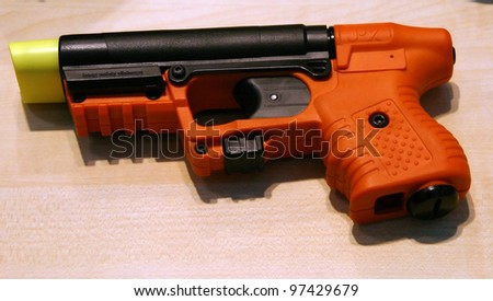 NURNBERG - MARCH 11: Plexon JPX Jet Protector pepper spray gun on display at IWA 2012 & OutdoorClassics exhibition on March 11, 2012 in Nurnberg, Germany - stock photo
