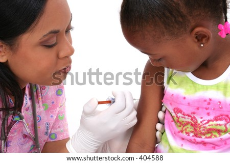 Nurse about to give small girl an injection. - stock photo