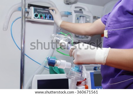 Nurse ambulance with oxygen mask in hand