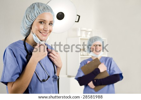 Nurse and doctor in a hospital surgery room with white background - stock photo