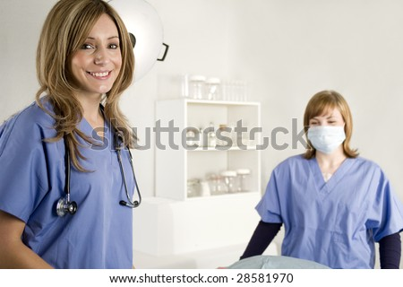 Nurse and doctor in a hospital surgical room - stock photo