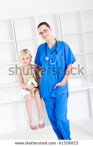 nurse and little girl patient - stock photo