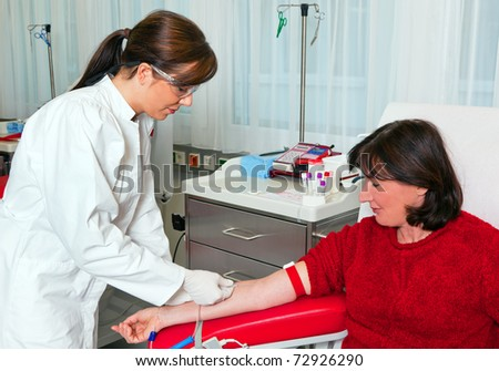 Nurse and patient blood samples. Donated blood in blood lab. - stock photo