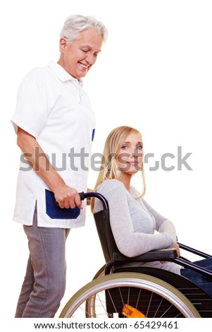 Nurse caring for a young woman in wheelchair