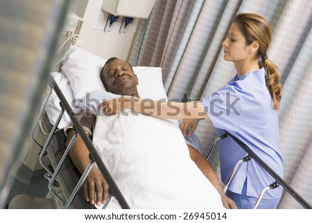 Nurse Caring For Patient - stock photo