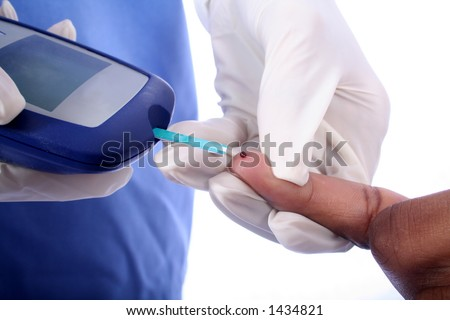 Nurse checking diabetic's blood sugar